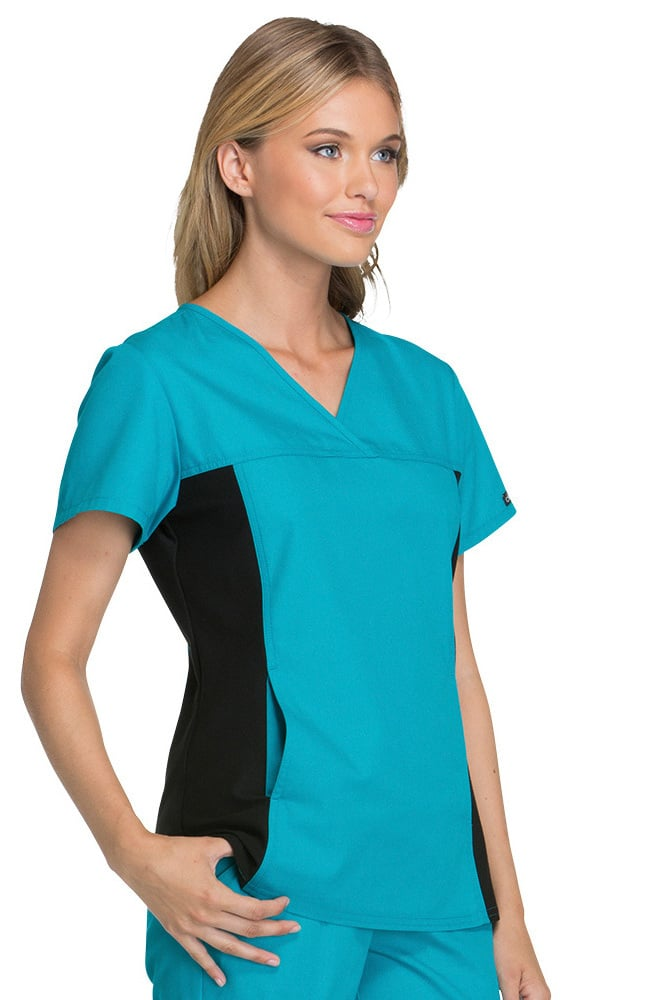 Finding well-fitted garments for a changing body is a chore, but have no fear! Allheart has an entire section dedicated to cute and professional attire for pregnant nurses. We recommend stretchy scrub tops like this Maternity Mock Wrap Top from the Flexibles by Cherokee collection. True to their name, this solid top provides side panels made from a polyester/spandex blend for ultimate flexibility.