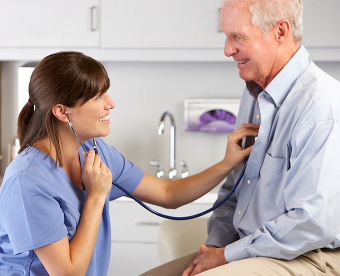 Doctor monitors patient using stethoscope