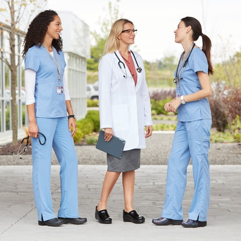 Medical professionals wearing slip resistant shoes