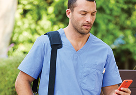 Male physician wears ciel blue scrub top