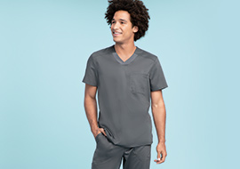 Male medical professional wearing gray scrubs