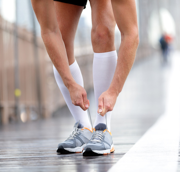 Male runner wearing white compression socks