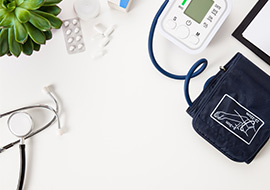Stethoscope and blood pressure monitor on desk