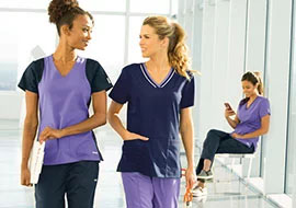 Nurses wearing purple Barco scrubs