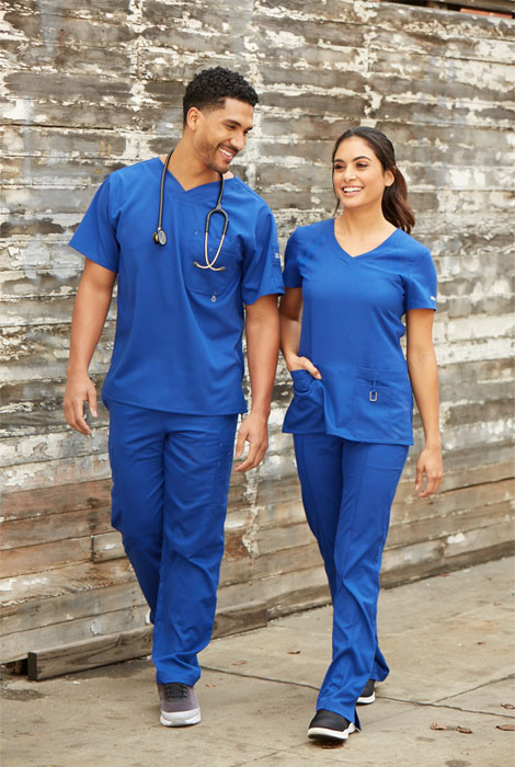 Two nurses wearing Grey's Anatomy™ royal blue scrubs