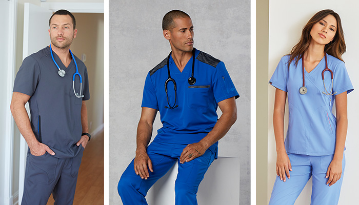 Two male and one female physician wearing blue scrubs