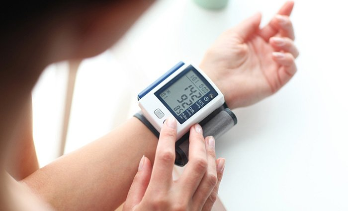 Female patient using wrist blood pressure monitor