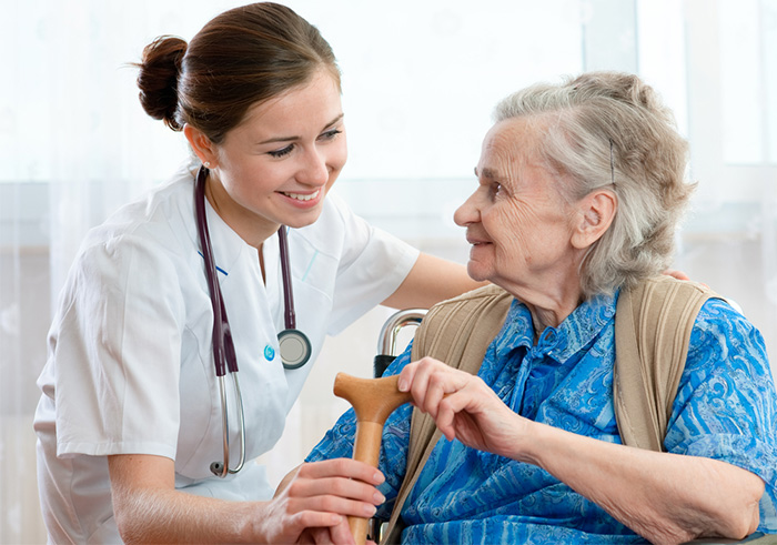 caregiver taking care of elderly patient