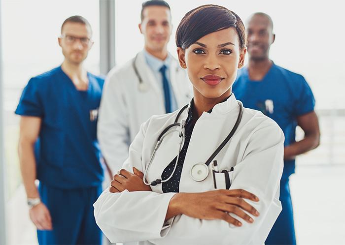 black female chief nursing officer in white lab coat