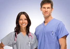 Female and male health care providers wearing flattering scrubs