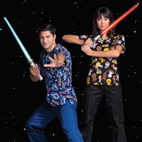 Female and male nurses wearing Cherokee Tooniforms holding lightsabers