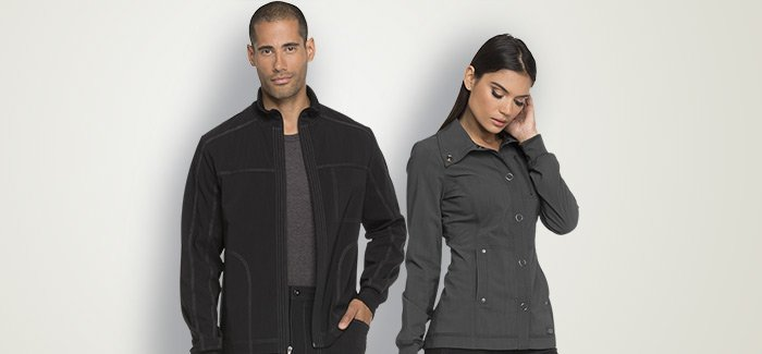 Female and male wearing dark scrub jackets