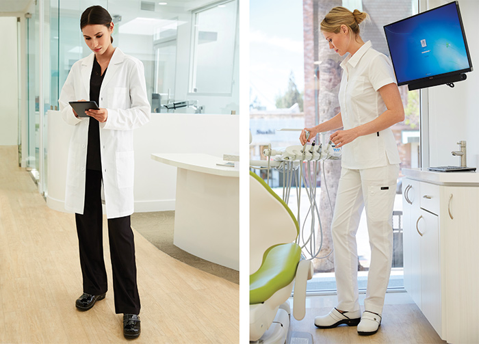 female medical professionals standing wearing clogs