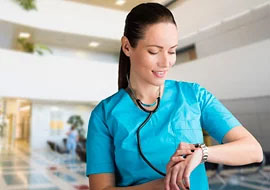 Female nurse checking wristwatch