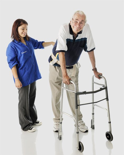Female nurse helping elderly man with gait belt