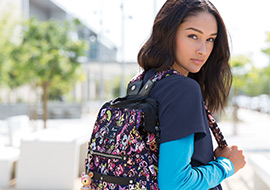 Female nurse wearing a colorful backpack