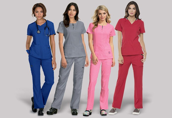 Female nurses modeling scrubs in different colors