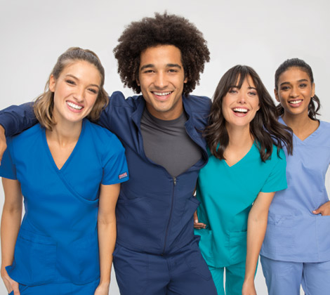 Group of female and male nurses wearing Cherokee scrubs in various colors