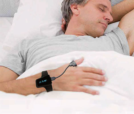 Man wearing BodiMetrics Sleep and Fitness Monitor