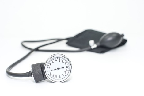 Manual sphygmomanometer device on white background