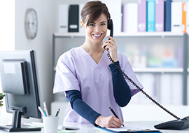 smiling medical assistant answering phone