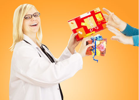 Doctors exchanging wrapped gifts