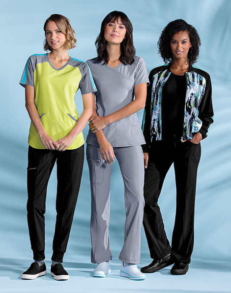 Three models wearing Infinity by Cherokee antimicrobial scrubs