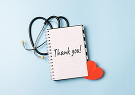 thank you concept for medical professionals with notebook and stethoscope