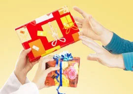Nurses holding up gifts for Nurses Week