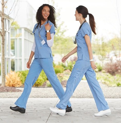 Two nurses wearing Dansko shoes