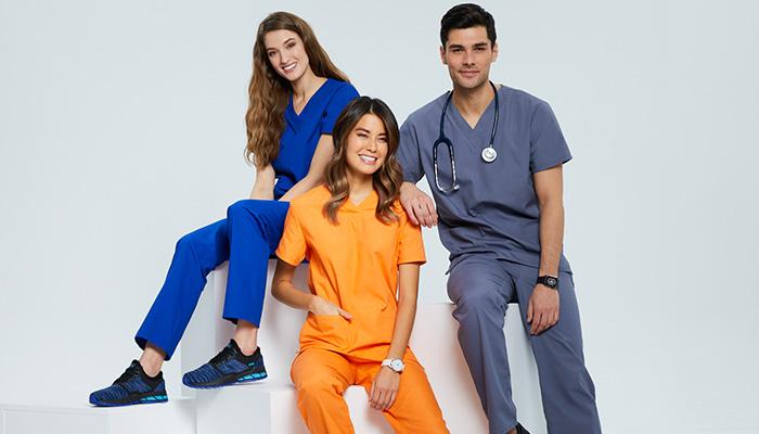 Medical professionals wear bright scrubs