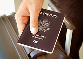 hand holding a passport for travel nursinge