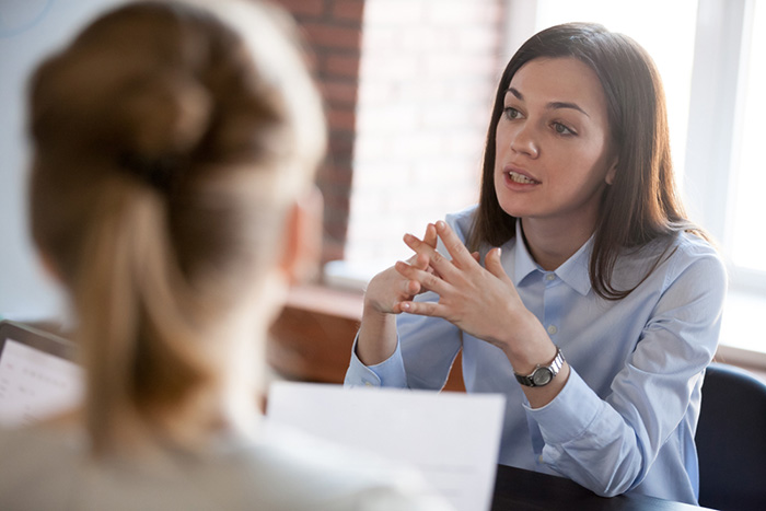 professional woman talking during a nursing interview