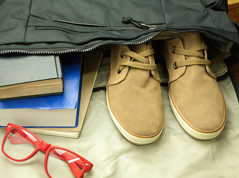 Shoes, books and glasses inside bag
