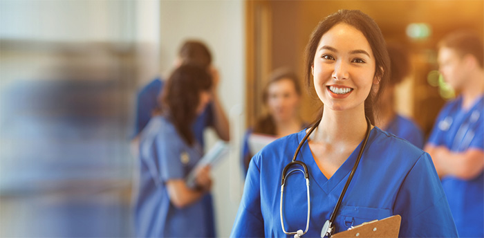 smiling medical student with clipboard and stethoscope