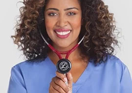 Smiling nurse wearing a burgundy Littmann stethoscope