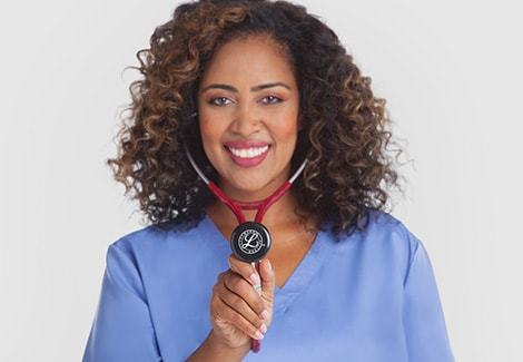 Respiratory therapist using burgundy Littmann stethoscope