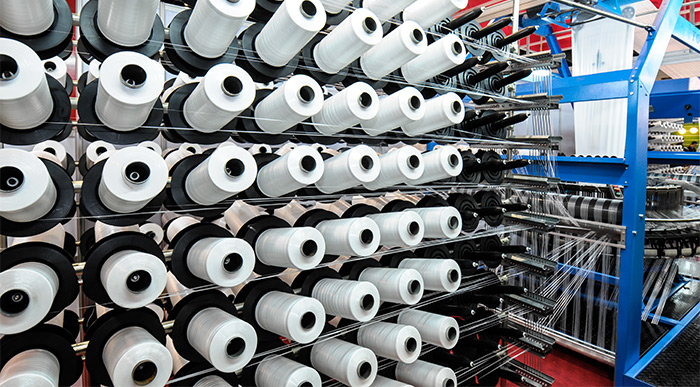 Rolls of thread inside textile factory