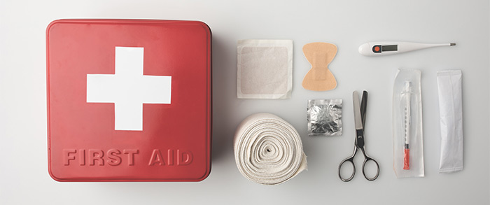 Top view of a first aid kit with emergency supplies