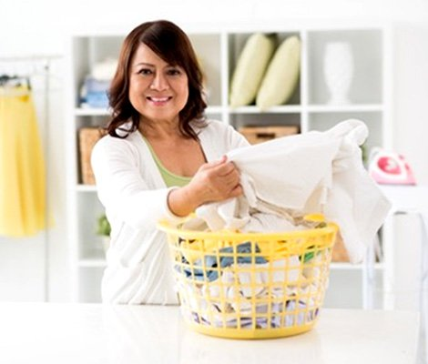 Woman folding clothes in laundry room