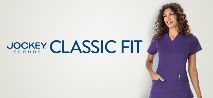 Woman wearing purple Classic Fit Jockey® scrubs